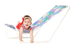 Cute baby lying on lounger Stock Image