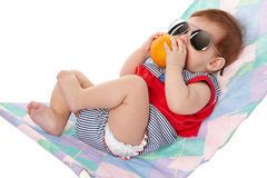 Cute baby lying on lounger Royalty Free Stock Photo