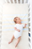 Cute baby lying in white cradle at sunny day royalty free stock image