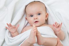 Cute baby lying on white towel Royalty Free Stock Photo
