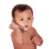 Cute baby make a phone call Royalty Free Stock Image
