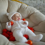 Cute baby with many tangerines Royalty Free Stock Photo
