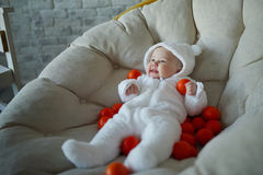 Cute baby with many tangerines Stock Photos