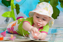 The cute baby on the map Royalty Free Stock Photo