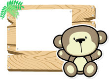 Cute baby monkey on wooden board Stock Photo