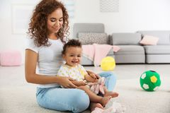 Cute baby and mother playing on floor Royalty Free Stock Photography