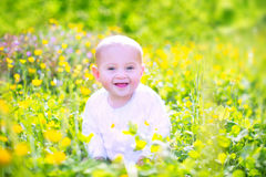Cute baby n a blooming garden Royalty Free Stock Photography