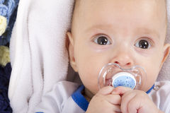 Cute baby with a nipple Royalty Free Stock Photo