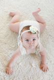 Cute Baby On The White Carpet