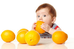 Cute baby with orange royalty free stock images