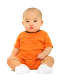 Cute Baby In Orange Shirt Puzzled Royalty Free Stock Image