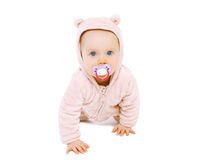 Cute baby with pacifier crawls. On a white background stock photography