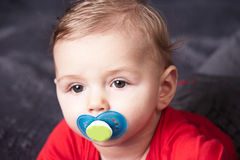 Cute baby with pacifier Stock Photography