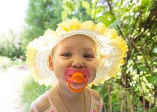 Cute baby with a pacifier in the sun.  Royalty Free Stock Image