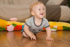 Cute baby with painted mustache crawls Royalty Free Stock Images
