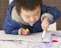 A cute baby is painting Royalty Free Stock Images