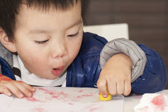 A cute baby is painting Royalty Free Stock Image