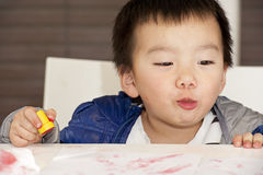 A cute baby is painting Stock Photo