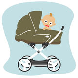 Cute baby peeks out from behind a green stroller pram Royalty Free Stock Image