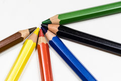 Cute baby pencil crayons on a white table. Isolated background. White background Royalty Free Stock Photo