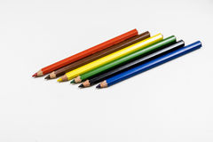 Cute baby pencil crayons on a white table. Isolated background. White background Royalty Free Stock Photos