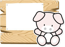 Cute baby pig on wooden board Royalty Free Stock Image