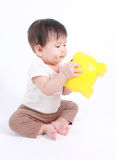 Cute baby with piggy bank Royalty Free Stock Photo