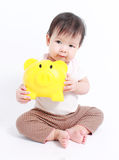 Cute baby with piggy bank Stock Images