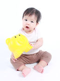 Cute baby with piggy bank Royalty Free Stock Photography