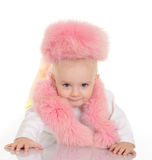 Cute baby in pink fur lying on white background Royalty Free Stock Image