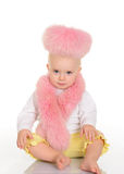 Cute baby in pink fur sitting on white background Royalty Free Stock Photos