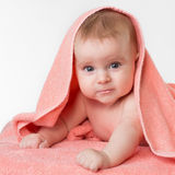 Cute baby in pink towel Stock Photo