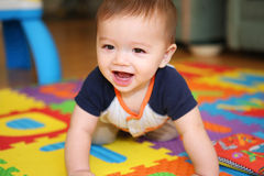 A cute baby playing Royalty Free Stock Photos
