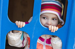Cute baby playing. Cute child playing at the playground royalty free stock image