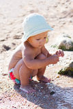 Cute baby playing on the beach Royalty Free Stock Images