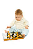 Cute baby playing chess Royalty Free Stock Photography