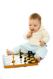 Cute baby playing chess Stock Images