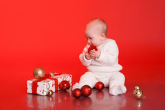 Cute baby playing with christmas presents and decorations Stock Photography