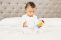 Cute baby playing with colorful toy Royalty Free Stock Photo