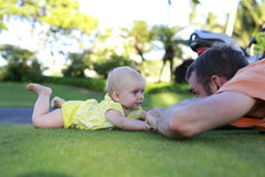 Cute baby is playing with father Royalty Free Stock Image