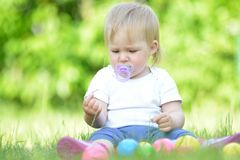 Cute baby playing on grass. Stock Images