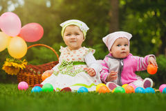 Cute baby is playing on the green grass Royalty Free Stock Photo