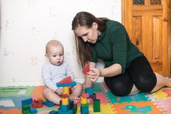 Cute baby playing with her mother Royalty Free Stock Image