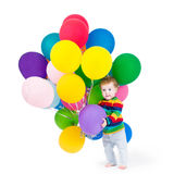 Cute baby playing with party balloons Royalty Free Stock Photo