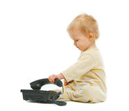 Cute baby playing with phone on white background Stock Photos