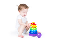 Cute baby playing with a plastic pyramid Stock Images