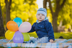 Cute baby are playing in the summer park Royalty Free Stock Photos