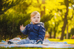 Cute baby are playing in the summer park Stock Image