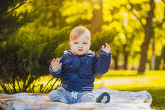 Cute baby are playing in the summer park Royalty Free Stock Image