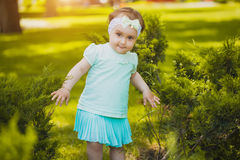 Cute baby are playing in the summer park Royalty Free Stock Photo